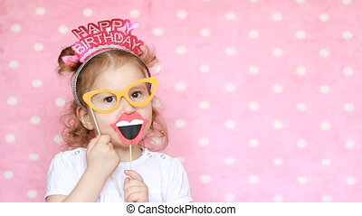 Happy birthday. Portrait sweet little girl with glasses, who...