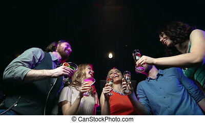 Happy Birthday - Low angle of five friends raising glasses...
