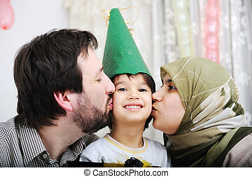 Happy birthday to you - muslim mother and father with their son