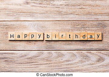 Happy Birthday word written on wood block