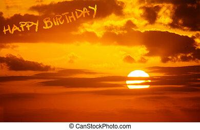 happy birthday written at sunset