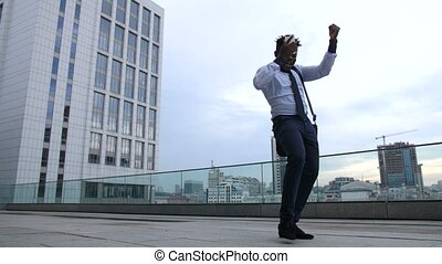 Happy black businessman celebrating promotion - Joyful...