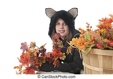 Happy Black Cat among Fall Foliage