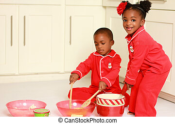 Happy black children cooking - Children making rice crispy ...