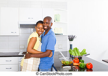 happy black couple in kitchen