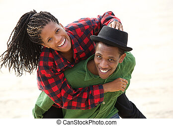 Happy black couple smiling outdoors
