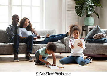 Happy black family spending free time together