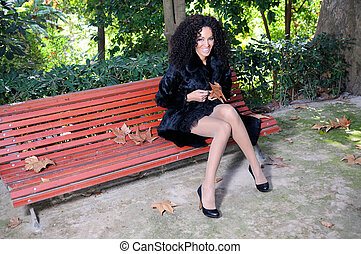 Happy black girl with braces in the park