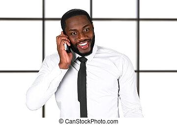Happy black man with phone.