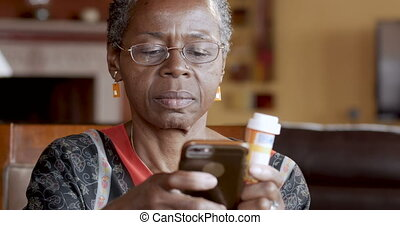 Happy black woman refilling her prescription drugs online...