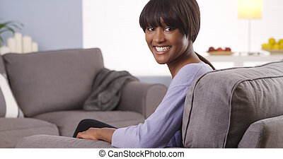 Happy black woman smiling at camera