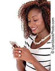 Happy black woman texting.