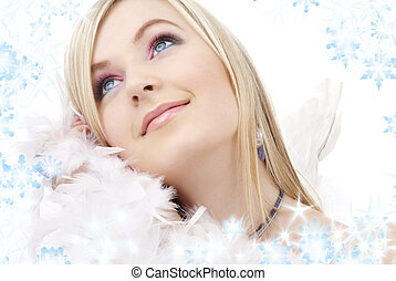 happy blond angel girl with feather boa - portrait of happy...