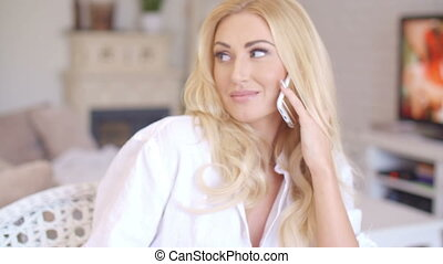 Happy Blond Female Calling at Phone Looking Left