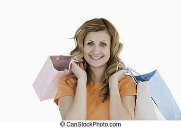 Happy blond-haired woman showing her shopping