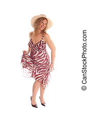 Happy blond woman dancing.