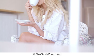 Happy Blond Woman in White Drinking Coffee