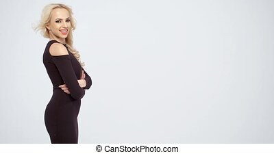 Happy blond woman laughing at the camera