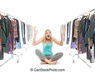 Happy blonde beauty in a wardrobe
