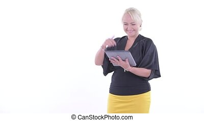 Happy blonde businesswoman using digital tablet and giving...