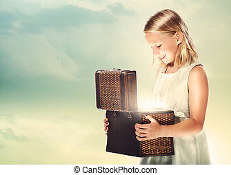 Happy Blonde Girl Opening a Treasure Box