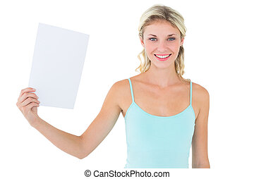 Happy blonde holding a sheet of paper