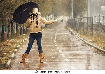 Happy blonde under rain - Happy young blond woman in a rainy...