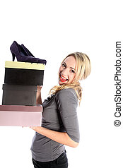 Happy Blonde Woman Holding Boxes of Shoes - Smiling...