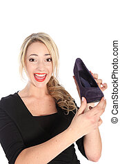 Happy Blonde Woman Holding Purple Shoe - Smiling friendly...