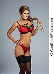 Happy blonde woman in lingerie