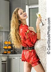 happy blonde woman in the modern kitchen