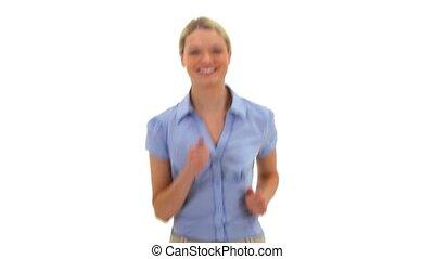 Happy blonde woman jogging