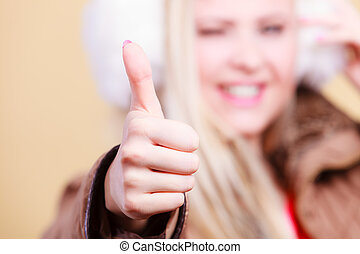 Happy blonde woman showing thumb up