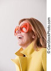 happy blonde woman wearing weird sunglasses - happy blonde...
