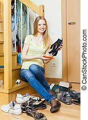Happy blonde woman with shoes