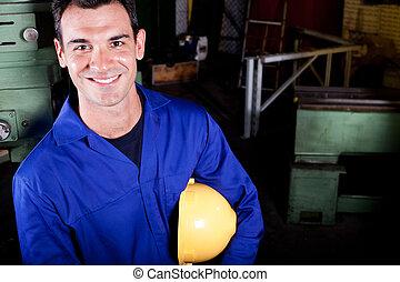 happy blue collar worker portrait in factory