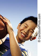 Happy boy - A happy boy holding a basketball