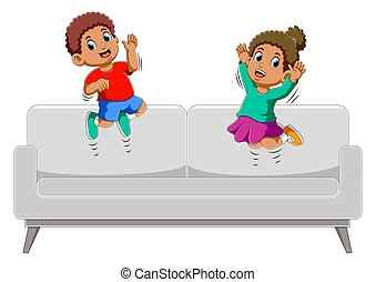 Happy Boy and girl jumping on sofa