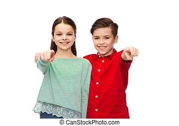 happy boy and girl pointing finger to you