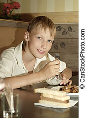 boy at breakfast on the table