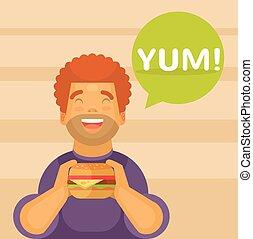 Happy boy eating a big hamburger