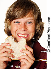 Happy boy eating a sandwich
