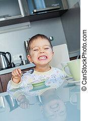 Happy Boy Eating Breakfast