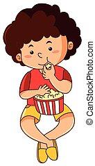 Happy boy eating popcorn