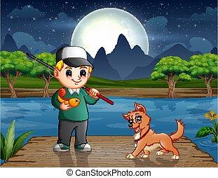 Happy boy fishing with a dog