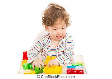 Happy boy having fun with toys