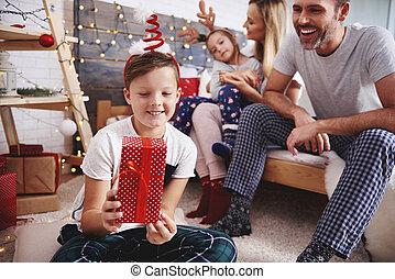 Happy boy holding christmas present
