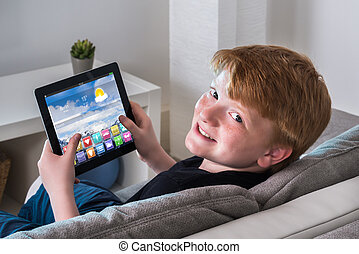 Happy Boy Holding Digital Tablet