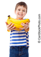 Happy boy holds a bunch of bananas - Happy boy stretches out...