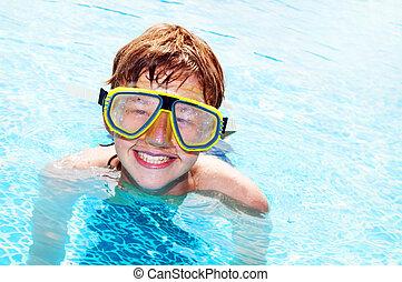 Happy boy in a pool